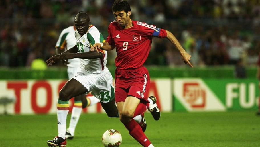 Hakan Sukur of Turkey and Lamine Diatta of Senegal