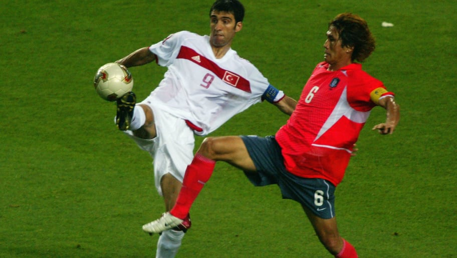 DAEGU - JUNE 29:  Hakan Sukur of Turkey controls the ball as Sang Chul Yoo of South Korea closes in during the FIFA World Cup Finals 2002 Third Place Play-Off match played at the Daegu World Cup Stadium, in Daegu, South Korea on June 29, 2002. Turkey won the match 3-2. DIGITAL IMAGE. (Photo by Ben Radford/Getty Images)