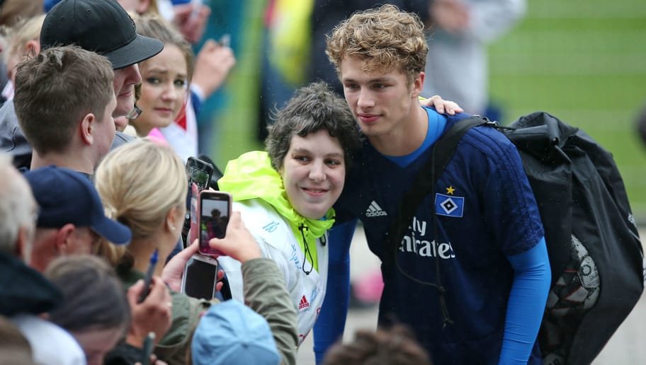 HAMBURG, GERMANY - JUNE 23: Jann Fiete Arp gives some autographs after the first training session of the new season at Volksparkstadion on June 23, 2018 in Hamburg, Germany. Hamburger SV were relegated to the Second Bundesliga at the end of the last season for the first time in the club's history. (Photo by Cathrin Mueller/Bongarts/Getty Images)