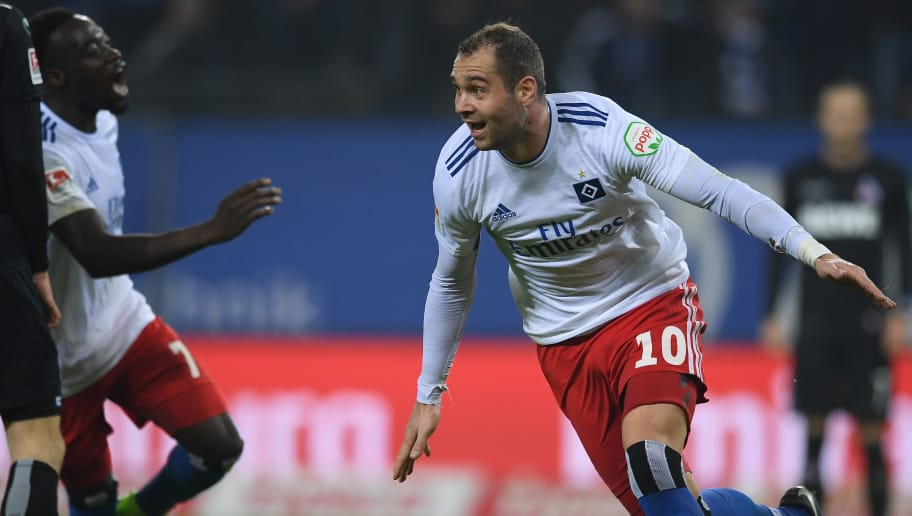 HAMBURG, GERMANY - NOVEMBER 05: Pierre Michel Lasogga of Hamburg celebrates after scoring his team's first goal during the Second Bundesliga match between Hamburger SV and 1. FC Koeln at Volksparkstadion on November 5, 2018 in Hamburg, Germany. (Photo by Oliver Hardt/Bongarts/Getty Images)