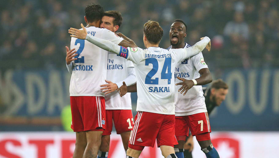 HAMBURG, GERMANY - NOVEMBER 05: (L-R) Leo Lacroix , Christoph Moritz , Goutoku Sakai and Khaled Narey of Hamburger SV celebrate after winning the Second Bundesliga match between Hamburger SV and 1. FC Koeln at Volksparkstadion on November 5, 2018 in Hamburg, Germany. (Photo by Cathrin Mueller/Bongarts/Getty Images)