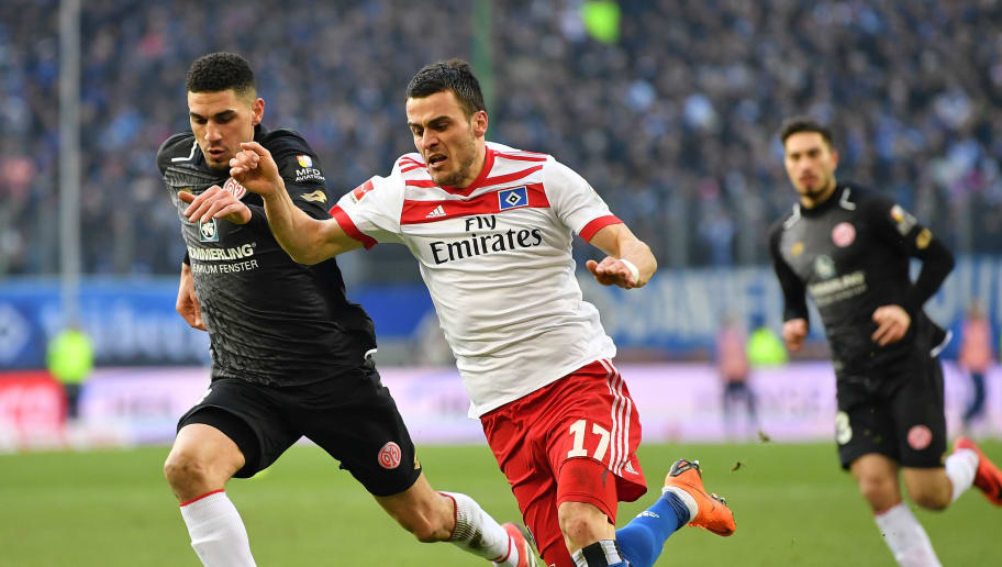 HAMBURG, GERMANY - MARCH 03:  Filip Kostic of Hamburg is challenged by Karim Onisiwo of Mainz during the Bundesliga match between Hamburger SV and 1. FSV Mainz 05 at Volksparkstadion on March 3, 2018 in Hamburg, Germany.  (Photo by Stuart Franklin/Bongarts/Getty Images)