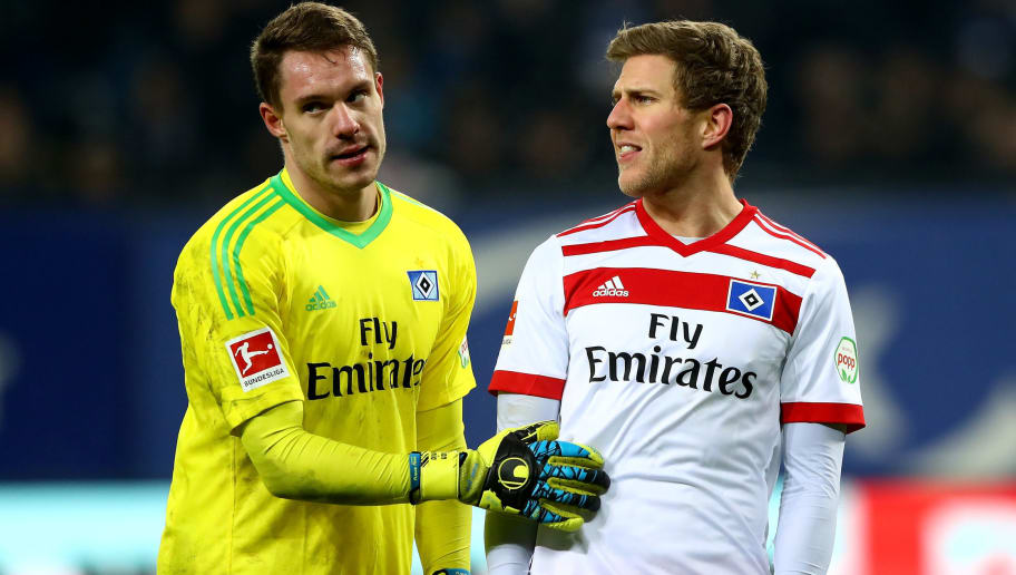 HAMBURG, GERMANY - DECEMBER 12:  Christian Mathenia (L), goalkeeper of Hamburg and team mate Sven Schipplock look dejected after the Bundesliga match between Hamburger SV and Eintracht Frankfurt at Volksparkstadion on December 12, 2017 in Hamburg, Germany.  (Photo by Martin Rose/Bongarts/Getty Images)