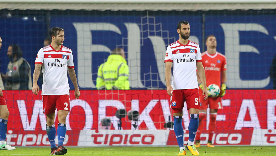 HAMBURG, GERMANY - OCTOBER 21: (L-R:) Kyriakos Papadopoulos, Dennis Diekmeier, Mergim Mavraj and Christian Mathenia of Hamburg look dejected after Bayern scored their first goal during the Bundesliga match between Hamburger SV and FC Bayern Muenchen at Volksparkstadion on October 21, 2017 in Hamburg, Germany. (Photo by Martin Rose/Bongarts/Getty Images)