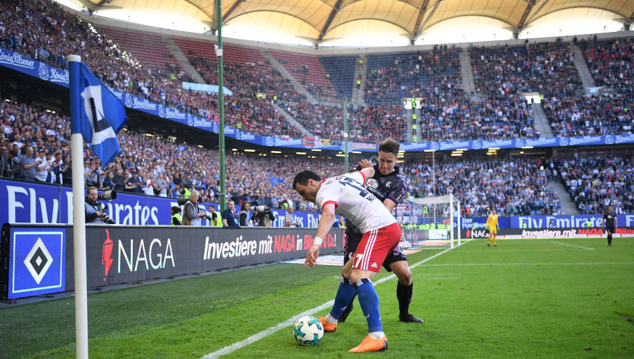 HAMBURG, GERMANY - APRIL 21:  Filip Kostic of Hamburg is challenged by Christian Guenter of Freiburg during the Bundesliga match between Hamburger SV and Sport-Club Freiburg at Volksparkstadion on April 21, 2018 in Hamburg, Germany.  (Photo by Stuart Franklin/Bongarts/Getty Images)