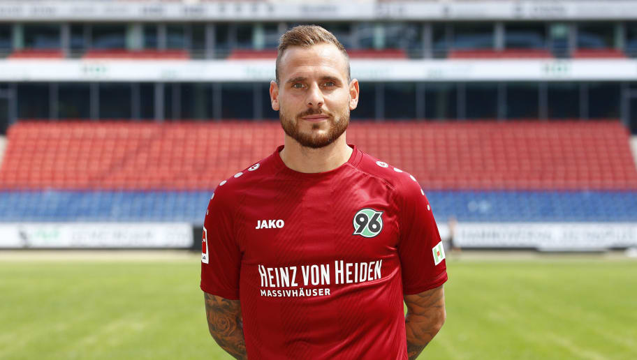 HANOVER, GERMANY - JULY 19: Marvin Bakalorz of Hannover 96 poses during the team presentation at HDI-Arena on July 19, 2018 in Hanover, Germany. (Photo by Joachim Sielski/Bongarts/Getty Images)