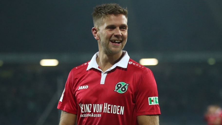 HANOVER, GERMANY - JANUARY 13:  Niclas Fuellkrug (R) of Hannover celebrates after his third goal during the Bundesliga match between Hannover 96 and 1. FSV Mainz 05 at HDI-Arena on January 13, 2018 in Hanover, Germany.  (Photo by Oliver Hardt/Bongarts/Getty Images)