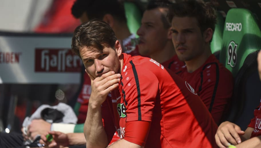 HANOVER, GERMANY - MAY 07:  Christian Schulz of Hannover sits on the bench prior to the Bundesliga match between Hannover 96 and 1899 Hoffenheim at HDI-Arena on May 7, 2016 in Hanover, Germany.  (Photo by Nigel Treblin/Bongarts/Getty Images)