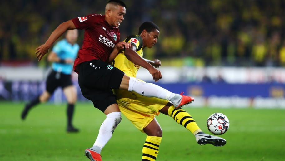 HANOVER, GERMANY - AUGUST 31:  Manuel Akanji of Borussia Dortmund clears from Bobby Wood of Hannover 96 during the Bundesliga match between Hannover 96 and Borussia Dortmund at HDI-Arena on August 31, 2018 in Hanover, Germany.  (Photo by Martin Rose/Bongarts/Getty Images)