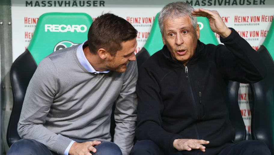 HANOVER, GERMANY - AUGUST 31:  Lucien Favre, Manager of Borussia Dortmund and player license director Sebastian Kehl in discussion prior to the Bundesliga match between Hannover 96 and Borussia Dortmund at HDI-Arena on August 31, 2018 in Hanover, Germany.  (Photo by Martin Rose/Bongarts/Getty Images)