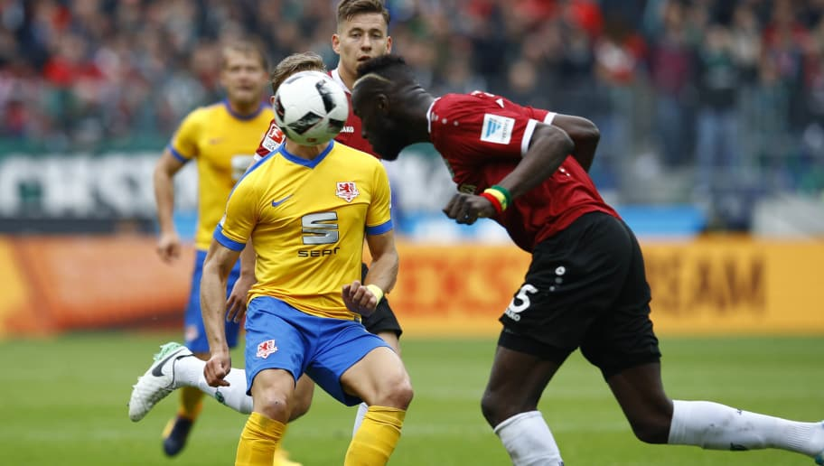 HANOVER, GERMANY - APRIL 15: Salif Sane of Hannover challenges Julius Biada of Braunschweig during the Second Bundesliga match between Hannover 96 and Eintracht Braunschweig at HDI-Arena on April 15, 2017 in Hanover, Germany. (Photo by Joachim Sielski/Bongarts/Getty Images)