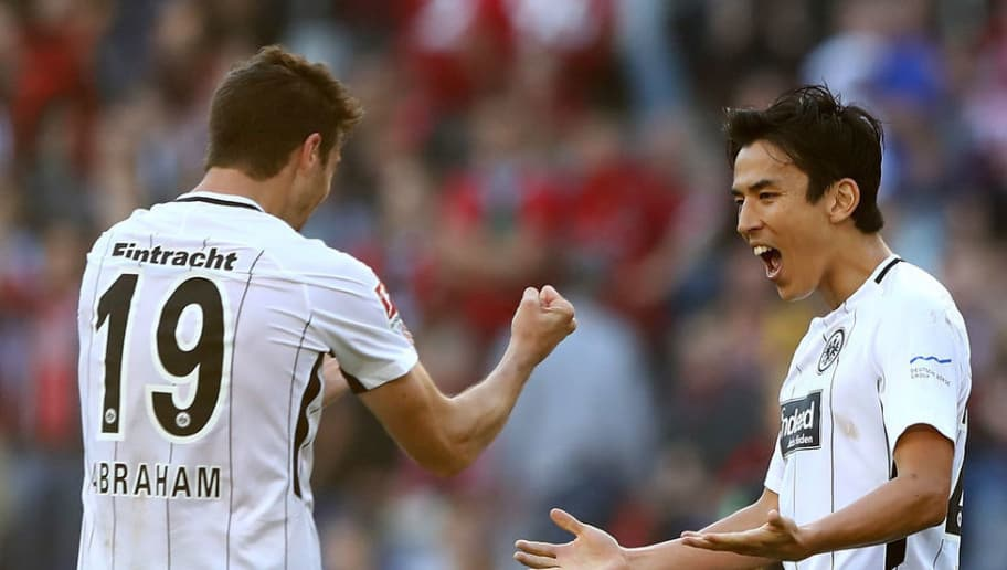 HANOVER, GERMANY - OCTOBER 14: (L-R) David Abraham, Makoto Hasebe and Marco Russ of Frankfurt celebrate victory the Bundesliga match between Hannover 96 and Eintracht Frankfurt at HDI-Arena on October 14, 2017 in Hanover, Germany.  (Photo by Martin Rose/Bongarts/Getty Images)
