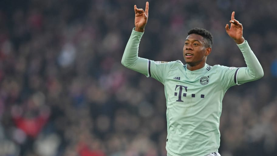 HANOVER, GERMANY - DECEMBER 15: David Alaba of Muenchen celebrates his teams second goal during the Bundesliga match between Hannover 96 and FC Bayern Muenchen at HDI-Arena on December 15, 2018 in Hanover, Germany. (Photo by Thomas Starke/Bongarts/Getty Images)