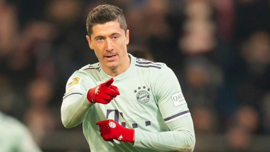 HANOVER, GERMANY - DECEMBER 15: Robert Lewandowski of Bayern Muenchen celebrates after scoring his team's fifth goal during the Bundesliga match between Hannover 96 and FC Bayern Muenchen at HDI-Arena on December 15, 2018 in Hanover, Germany. (Photo by TF-Images/TF-Images via Getty Images)