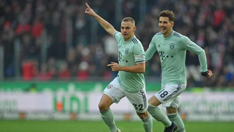 HANOVER, GERMANY - DECEMBER 15: Joshua Kimmich (L) and Leon Goretzka of Muenchen celebrate their teams first goal during the Bundesliga match between Hannover 96 and FC Bayern Muenchen at HDI-Arena on December 15, 2018 in Hanover, Germany. (Photo by Thomas Starke/Bongarts/Getty Images)