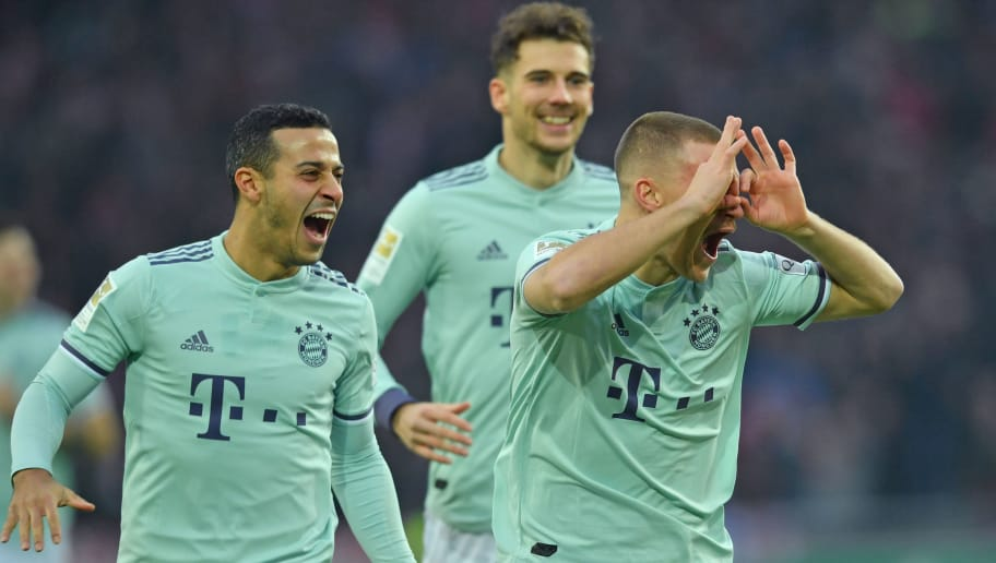 HANOVER, GERMANY - DECEMBER 15: (L-R) Thiago, Leon Goretzka and Joshua Kimmich of Muenchen celebrate their teams first goal during the Bundesliga match between Hannover 96 and FC Bayern Muenchen at HDI-Arena on December 15, 2018 in Hanover, Germany. (Photo by Thomas Starke/Bongarts/Getty Images)