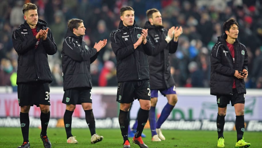 HANOVER, GERMANY - DECEMBER 15: (L-R) Waldemar Anton, Pirmin Schwegler, Kevin Wimmer, Michael Esser and Genki Haraguchi of Hannover look dejected after losing the Bundesliga match between Hannover 96 and FC Bayern Muenchen at HDI-Arena on December 15, 2018 in Hanover, Germany. (Photo by Thomas Starke/Bongarts/Getty Images)