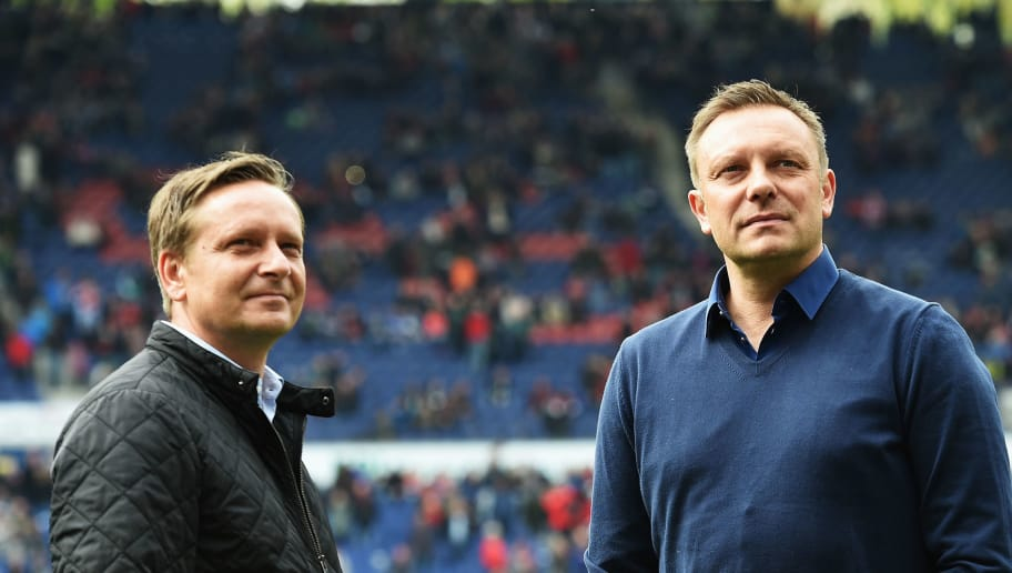 HANOVER, GERMANY - APRIL 30:  Andr�� Breitenreiter, head coach of Schalke looks on with Horst Held, manager of Schalke during the Bundesliga match between Hannover 96 and FC Schalke 04 at the HDI Arena on April 30, 2016 in Hanover, Lower Saxony.  (Photo by Stuart Franklin/Bongarts/Getty Images)