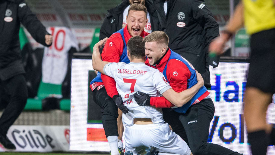 HANOVER, GERMANY - DECEMBER 22: Oliver Fink (C) of Düsseldorf celebrates after scoring their first goal with Robin Bormuth (L) and Jean Zimmer (R) during the Bundesliga match between Hannover 96 and Fortuna Duesseldorf at HDI-Arena on December 22, 2018 in Hanover, Germany. (Photo by Lukas Schulze/Bongarts/Getty Images)