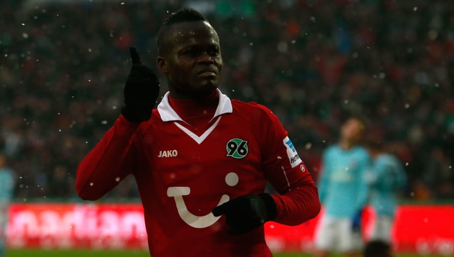 HANNOVER, GERMANY - FEBRUARY 23:  Didier Ya Konan of Hannover celebrates after scoring his team's fourth goal during the Bundesliga match between Hannover 96 and Hamburger SV at AWD Arena on February 23, 2013 in Hannover, Germany.  (Photo by Joern Pollex/Bongarts/Getty Images)