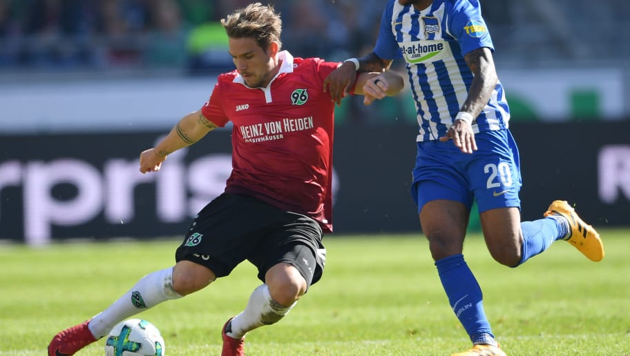 HANOVER, GERMANY - MAY 05:  Oliver Sorg of Hannover is challenged by Valentino Lazaro of Berlin during the Bundesliga match between Hannover 96 and Hertha BSC at HDI-Arena on May 5, 2018 in Hanover, Germany.  (Photo by Stuart Franklin/Bongarts/Getty Images)