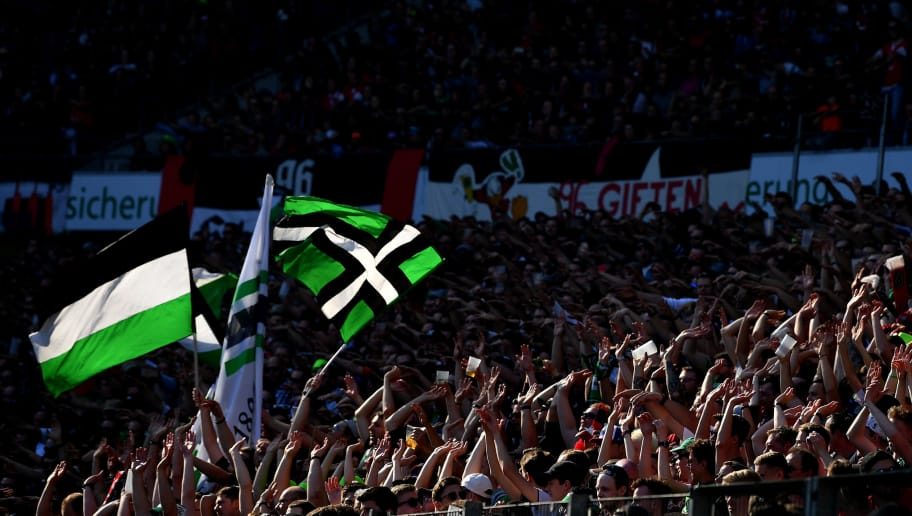 HANOVER, GERMANY - MAY 05:  Fans of Hannover show their support during the Bundesliga match between Hannover 96 and Hertha BSC at HDI-Arena on May 5, 2018 in Hanover, Germany.  (Photo by Stuart Franklin/Bongarts/Getty Images)