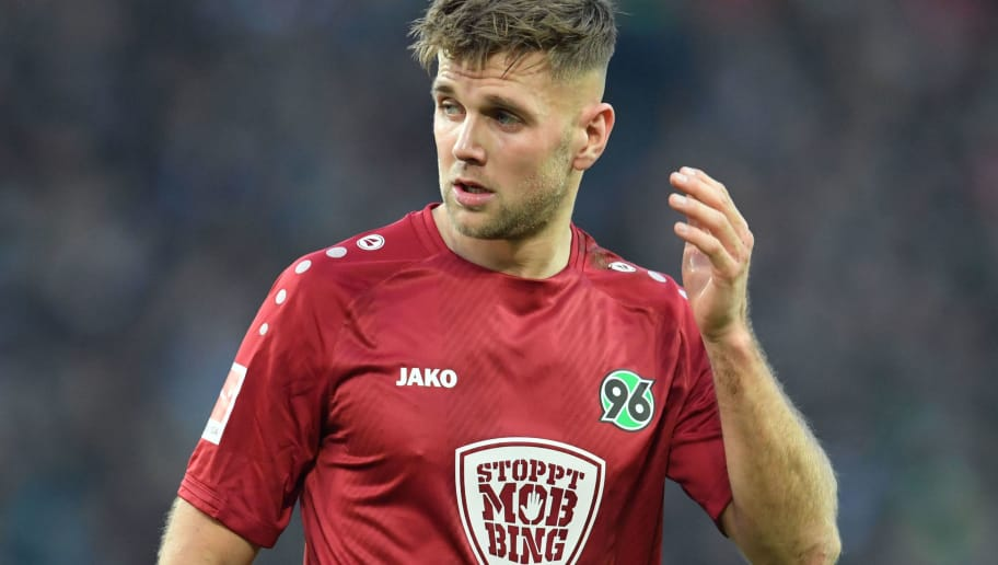 HANOVER, GERMANY - DECEMBER 01: Niclas Fuellkrug of Hannover wears the special jersey saying 'Stop Mobbing' during the Bundesliga match between Hannover 96 and Hertha BSC at HDI-Arena on December 1, 2018 in Hanover, Germany. (Photo by Thomas Starke/Bongarts/Getty Images)