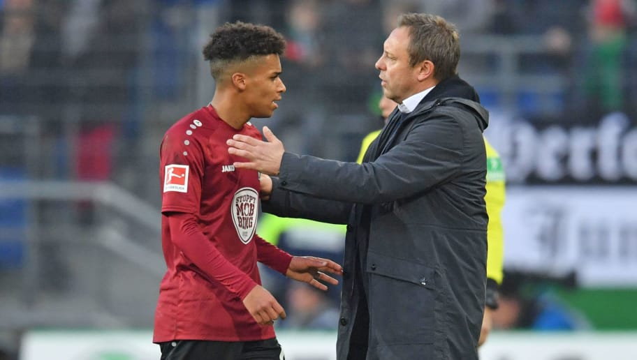 HANOVER, GERMANY - DECEMBER 01: Linton Maina (L) talks to head coach Andre Breitenreiter of Hannover during the Bundesliga match between Hannover 96 and Hertha BSC at HDI-Arena on December 1, 2018 in Hanover, Germany. (Photo by Thomas Starke/Bongarts/Getty Images)