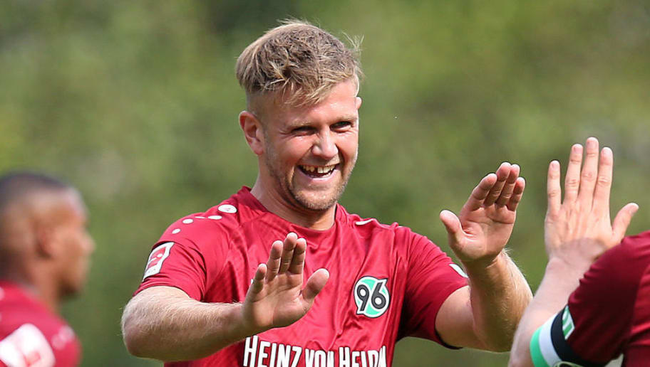 ILTEN, GERMANY - JULY 21: Niclas Fuellkrug of Hannover (L) and Pirmin Schwegler of Hannover celebrate after scoring during the preseason friendly match between Hannover 96 and PEC Zwolle at Wahre Dorff Arena on July 21, 2018 in Ilten, Germany. (Photo by Cathrin Mueller/Bongarts/Getty Images)