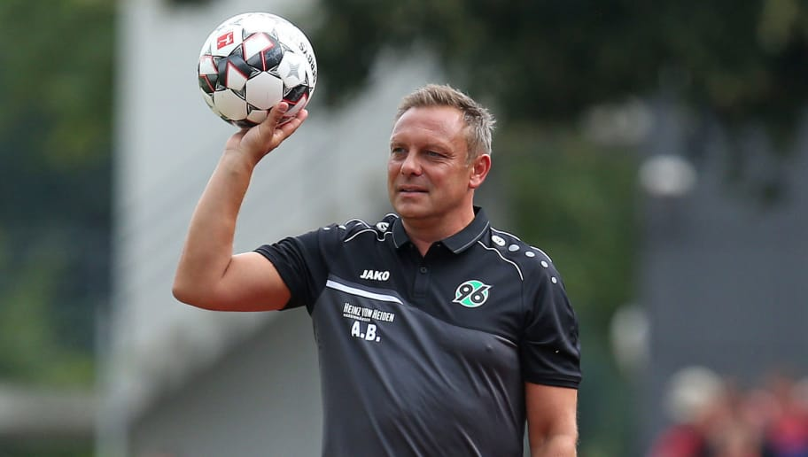 ILTEN, GERMANY - JULY 21: Andre Breitenreiter, head coach of Hannover keep a ball during the preseason friendly match between Hannover 96 and PEC Zwolle at Wahre Dorff Arena on July 21, 2018 in Ilten, Germany. (Photo by Cathrin Mueller/Bongarts/Getty Images)
