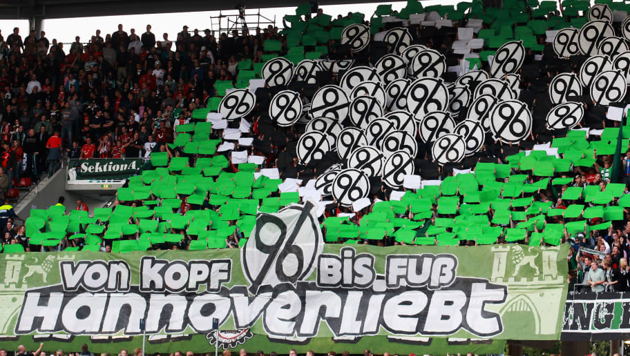 HANNOVER, GERMANY - SEPTEMBER 15: Fans display their clubs logo prior to the UEFA Europa League Group B match between Hannover 96 and R. Standard de Liege at AWD Arena on September 15, 2011 in Hannover, Germany.  (Photo by Joern Pollex/Bongarts/Getty Images)