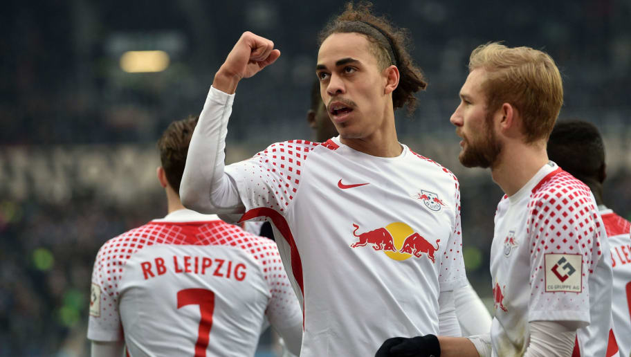 HANOVER, GERMANY - MARCH 31: Yussuf Poulsen (C) of Leipzig celebrates his teams third goal during the Bundesliga match between Hannover 96 and RB Leipzig at HDI-Arena on March 31, 2018 in Hanover, Germany. (Photo by Thomas Starke/Bongarts/Getty Images)