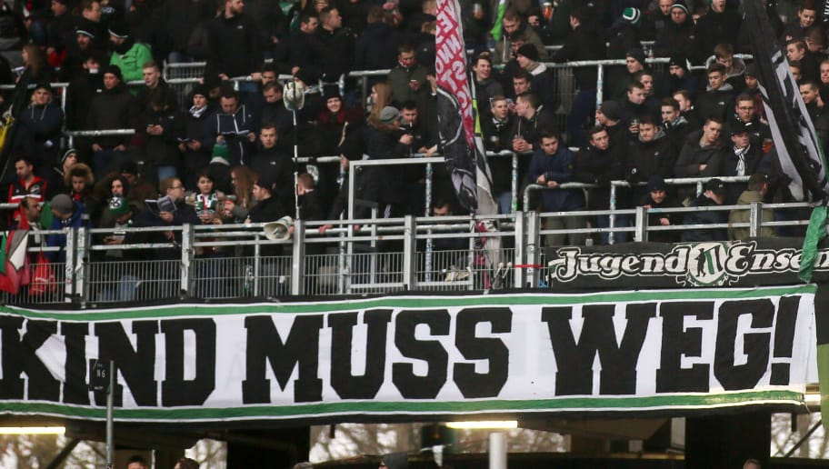 HANOVER, GERMANY - FEBRUARY 10: Hannover fans with a banner ' Kind muss weg ' during the Bundesliga match between Hannover 96 and Sport-Club Freiburg at HDI-Arena on February 10, 2018 in Hanover, Germany. (Photo by Selim Sudheimer/Bongarts/Getty Images)