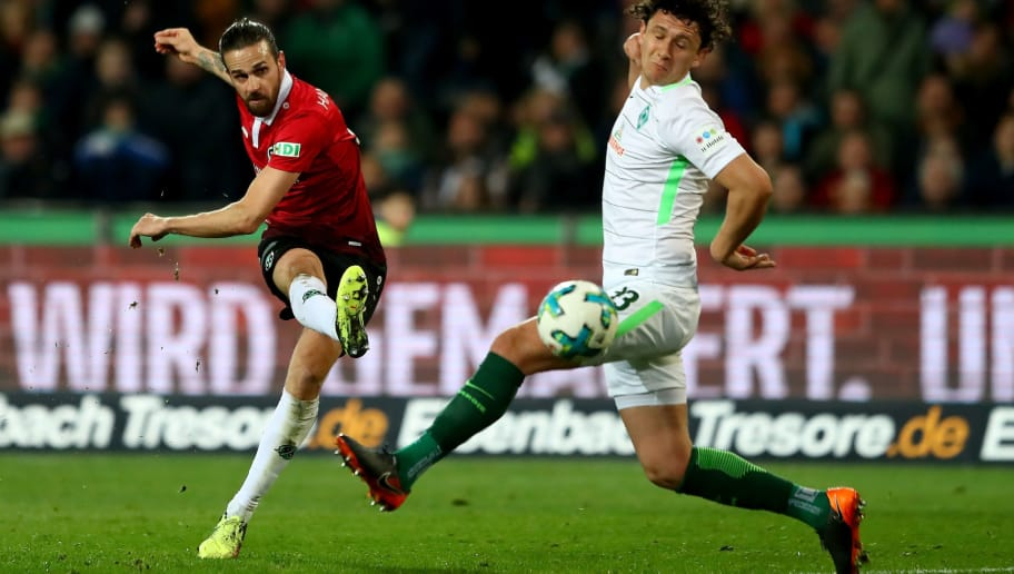 HANOVER, GERMANY - APRIL 06: Martin Harnik (L) of Hannover and Milos Veljkovic of Bremen battle for the ball during the Bundesliga match between Hannover 96 and SV Werder Bremen at HDI-Arena on April 6, 2018 in Hanover, Germany.  (Photo by Martin Rose/Bongarts/Getty Images)
