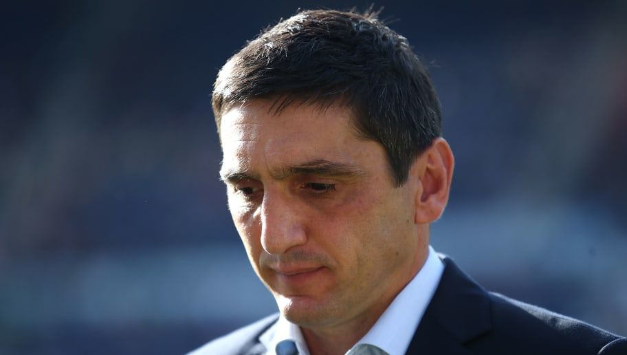 HANOVER, GERMANY - OCTOBER 06: Head coach Tayfun Korkut of Stuttgart looks up prior to the Bundesliga match between Hannover 96 and VfB Stuttgart at HDI-Arena on October 6, 2018 in Hanover, Germany. (Photo by Oliver Hardt/Bongarts/Getty Images)