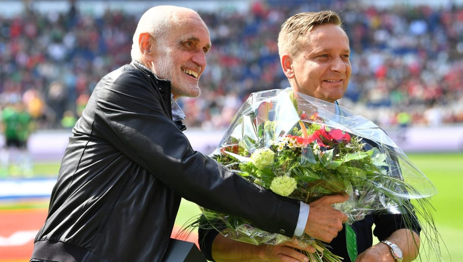 HANOVER, GERMANY - MAY 14:  Martin Kind, president of Hannover pretends to give Horst Heldt, sports director of Hannover flowers before the Second Bundesliga match between Hannover 96 and VfB Stuttgart at HDI-Arena on May 14, 2017 in Hanover, Germany.  (Photo by Stuart Franklin/Bongarts/Getty Images)