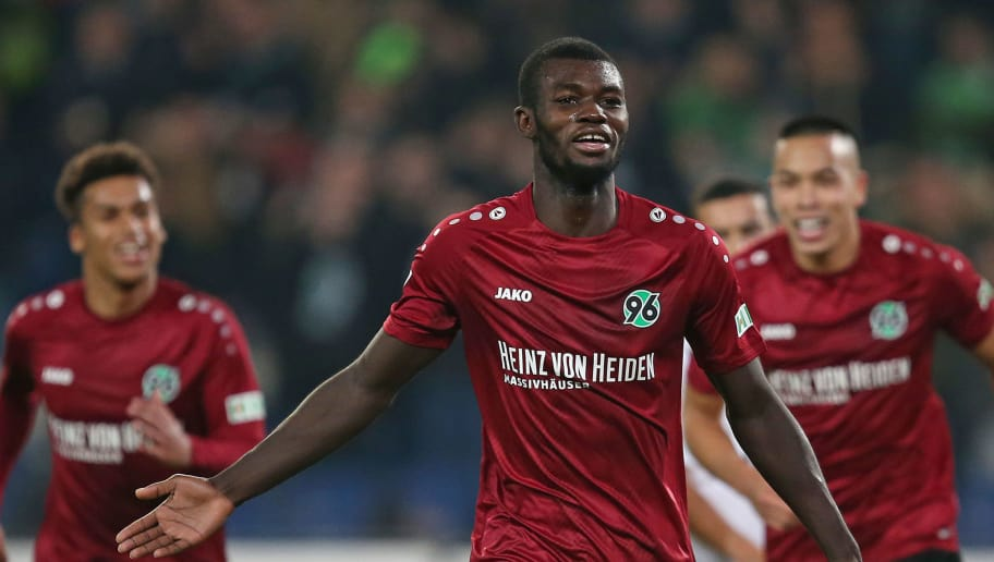 HANOVER, GERMANY - NOVEMBER 09: Ihlas Bebou (C)  of Hannover 96 celebrates after scoring during the Bundesliga match between Hannover 96 and VfL Wolfsburg at HDI-Arena on November 9, 2018 in Hanover, Germany. (Photo by Cathrin Mueller/Bongarts/Getty Images)