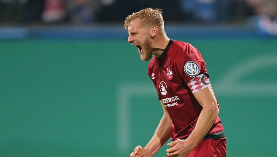 ROSTOCK, GERMANY - OCTOBER 31: Hanno Behrens of 1. FC Nuernberg celebrates after scoring in the penalty shooting during the DFB Cup second round match between Hansa Rostock and 1. FC Nuernberg at Ostseestadion on October 31, 2018 in Rostock, Germany. (Photo by Cathrin Mueller/Bongarts/Getty Images)