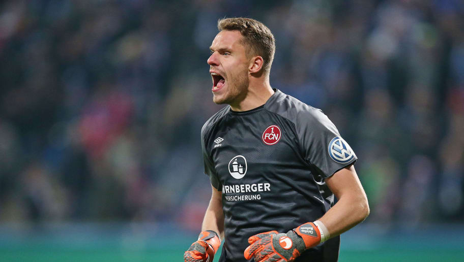 ROSTOCK, GERMANY - OCTOBER 31: Christian Mathenia, goalkeeper of 1. FC Nuernberg shouts during the DFB Cup second round match between Hansa Rostock and 1. FC Nuernberg at Ostseestadion on October 31, 2018 in Rostock, Germany. (Photo by Cathrin Mueller/Bongarts/Getty Images)