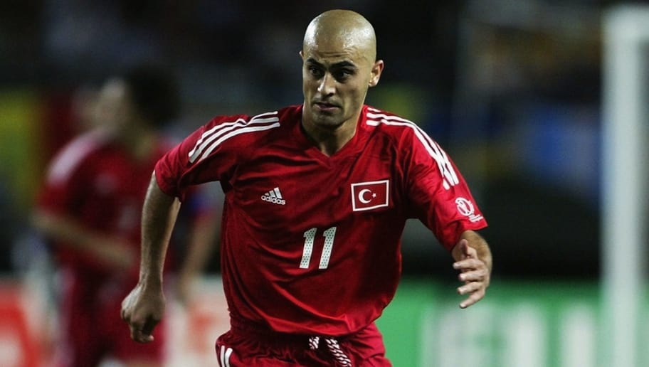 OSAKA - JUNE 22:  Hasan Sas of Turkey runs with the ball during the FIFA World Cup Finals 2002 Quarter Finals match between Senegal and Turkey played at the Osaka-Nagai Stadium, in Osaka, Japan on June 22, 2002. Turkey won the match 1-0 with a Golden Goal in extra-time. DIGITAL IMAGE. (Photo by Laurence Griffiths/Getty Images)
