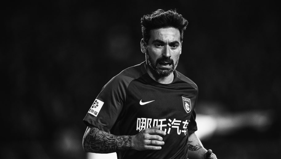 LANGFANG, CHINA - APRIL 07:  (EDITORS NOTE: IMAGE CONVERTED TO BLACK AND WHITE) Ezequiel Lavezzi #22 of Hebei China Fortune in action during the 2018 Chinese Super League match between Hebei China Fortune and Changchun Yatai at Langfang Sports Center on April 7, 2018 in Langfang, China.  (Photo by XIN LI/Getty Images)