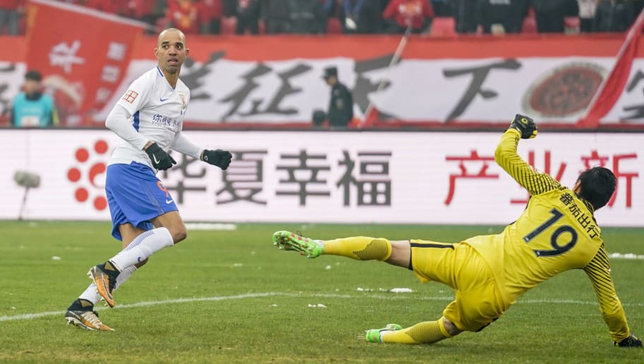 LANGFANG, CHINA - MARCH 17:  Diego Tardelli Martins #9 of Shandong Luneng Taishan in action during the 2018 Chinese Super League match between Hebei China Fortune and Shandong Luneng Taishan on March 17, 2018 in Langfang, China.  (Photo by XIN LI/Getty Images)