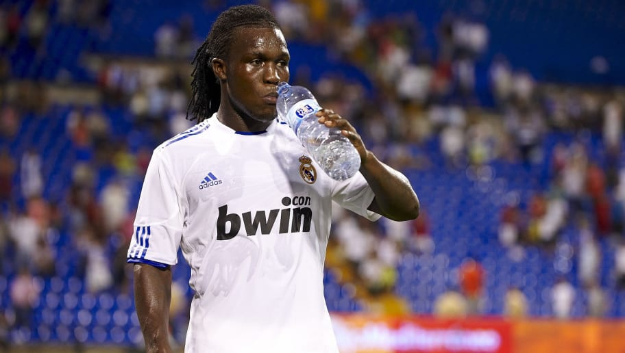 ALICANTE, SPAIN - AUGUST 22:  Royston Drenthe of Real Madrid drinks water after the pre-season friendly soccer match between Hercules and Real Madrid at Jose Rico Perez stadium on August 22, 2010 in Alicante, Spain. Real Madrid won 3-1.  (Photo by Manuel Queimadelos Alonso/Getty Images)