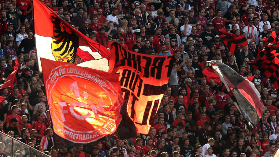 BERLIN, GERMANY - AUGUST 25:  Supporters of Nuernberg are pictured during the Bundesliga match between Hertha BSC and 1. FC Nuernberg at Olympiastadion on August 25, 2018 in Berlin, Germany. (Photo by Matthias Kern/Bongarts/Getty Images)