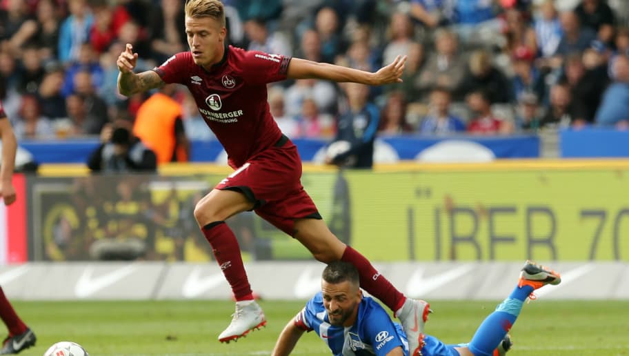 BERLIN, GERMANY - AUGUST 25:  Vedad Ibisevic (R) of Berlin battles for the ball with Ondrej Petrak of Nuernberg during the Bundesliga match between Hertha BSC and 1. FC Nuernberg at Olympiastadion on August 25, 2018 in Berlin, Germany.  (Photo by Matthias Kern/Bongarts/Getty Images)