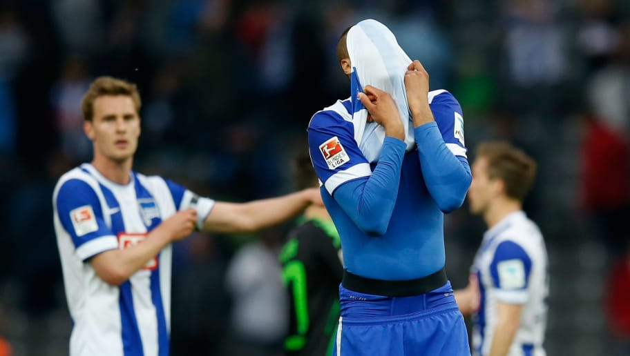 BERLIN, GERMANY - MAY 03:  John Anthony Brooks (R) and team mates of Berlin show their frustration after losing the Bundesliga match between Hertha BSC and Borussia Moenchengladbach at Olympiastadion on May 3, 2015 in Berlin, Germany.  (Photo by Boris Streubel/Bongarts/Getty Images)