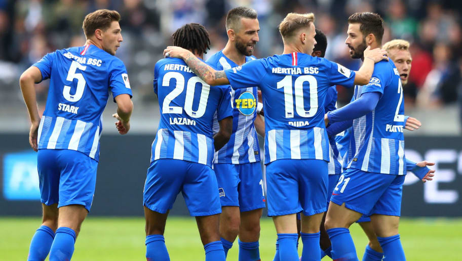 BERLIN, GERMANY - SEPTEMBER 22:  Vedad Ibisevic of Hertha BSC celebrates with teammates after scoring his team's first goal during the Bundesliga match between Hertha BSC and Borussia Moenchengladbach at Olympiastadion on September 22, 2018 in Berlin, Germany.  (Photo by Martin Rose/Bongarts/Getty Images)