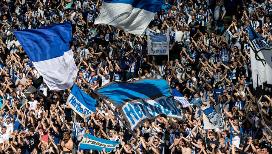 BERLIN, GERMANY - APRIL 28: Hertha fans wave flaggs during the Bundesliga match between Hertha BSC and FC Augsburg at Olympiastadion on April 28, 2018 in Berlin, Germany. (Photo by Boris Streubel/Bongarts/Getty Images)