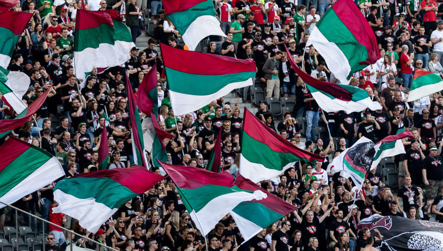 BERLIN, GERMANY - APRIL 28: Augsburg fans wave flaggs during the Bundesliga match between Hertha BSC and FC Augsburg at Olympiastadion on April 28, 2018 in Berlin, Germany. (Photo by Boris Streubel/Bongarts/Getty Images)