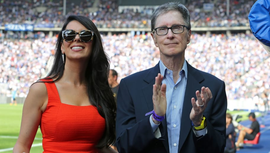 BERLIN, GERMANY - JULY 29:  Club owner John Henry (R) of Liverpool and his wife Linda Pizutti look on prior to the pre season friendly match between Hertha BSC and FC Liverpool at Olympiastadion on July 29, 2017 in Berlin, Germany. (Photo by Matthias Kern/Bongarts/Getty Images)